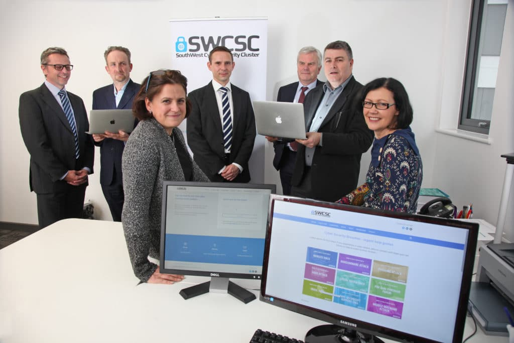 PIC: MARK PASSMORE/APEX 06/12/2016 South West Cyber Security Cluster, Exeter Science Park, Devon. (Rear L-R) Pete Woodward, Paul Evans, Durgan Cooper, Anthony Odhams, Geoff Ravill. (Front L-R) Kate Doodson and Roz Woodward. ---------------------------------------------------- APEX NEWS AND PICTURES NEWS DESK: 01392 823144 PICTURE DESK: 01392 823145